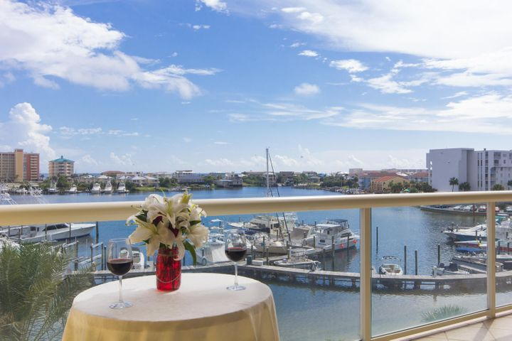 Sip a glass of Wine while enjoying the Harbor Action.