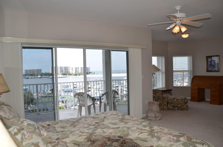 Waterfront master Bedroom has a sitting area plus a private balcony
