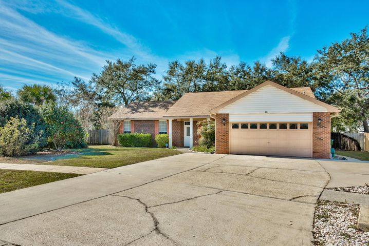 Features an oversized driveway for ample parking.