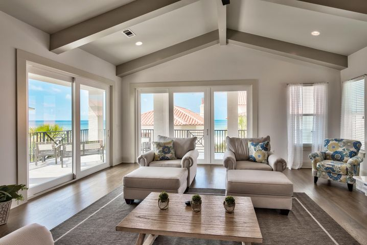 Phenomenal, newly constructed corner home with breathtaking views & additional privacy located on the east end of the community. This is an exceptional Gulf view end lot just one tier back from the Gulf with easy access to the private beach boardwalk. The main living area and kitchen is positioned on the top floor to maximize the Gulf views and features elegant stained oak flooring. Craftsman touches like the custom beams & cathedral ceilings create a beautiful spacious setting. Enjoy an expansive oversized wraparound balcony with 13 ft depth - a true extension of the home & perfect place to take in the Gulf views, relax, dine & entertain! Beautiful and classic Mediterranean architecture set the tone reminiscent of a quaint, coastal European town. Escape to luxury beach living at Vizcaya! The home features a very open floor plan, a 2-car garage, private elevator, brand new coastal decor, 10 foot ceilings on the 1st & second floor and cathedral ceilings on the top floor. There is a custom top of the line kitchen with stainless steel appliances, gas range, beautiful Quartz countertops & breakfast bar island, contemporary cabinets, classic subway tile backsplash and a pantry. The living area is very inviting with the custom stone tiled gas fireplace and picturesque views. Plenty of room to relax or entertain along with a large flat screen TV. There is a formal dining room with beautiful natural light and stunning oak floors on the top and second level.   The master suite is located on the second level and is beautifully done. This room is very spacious with a king bed, walk-in closet and breathtaking en-suite master bathroom. The master bath tile extends from the floor to the walls for a unique contemporary look. There is a double vanity, Quartz countertops, separate custom tiled shower and Jacuzzi tub to unwind in. There are two spacious guest bedrooms on this level as well, one with a queen bed and the other with two full beds. There is a lovely shared guest bathroom with tile floors, Quartz countertops and contemporary cabinets. The first floor features two bedroom both with en-suite bathrooms for convenience and privacy. Both rooms features contemporary tile flooring and one room is being used as a deluxe bunk room which is great for rentals! There is a laundry room on this level with a full size washer & dryer and upper shelving. This home is sure to impress and is being sold fully furnished & decorated. It is currently a beach rental with ResortQuest by Wyndham Vacation Rentals and is projected to gross nearly $185,000! Vizcaya is a low density quiet oasis with only 32 residences offering a private pool with bar area, pool cabanas and three beach walk overs providing easy access to 1,000 feet of beach frontage for your personal enjoyment. This is a phenomenal opportunity.