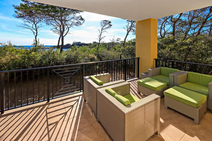 Stunning Lake and Gulf Views from this oversized balcony.