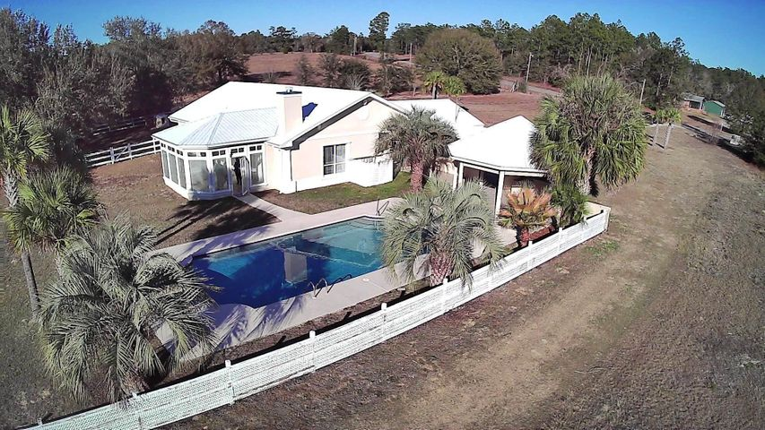 Welcome home to your oasis! Over 3 acres!