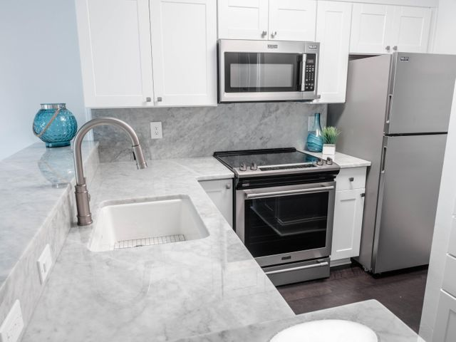 Fully remodeled kitchen with new appliances.