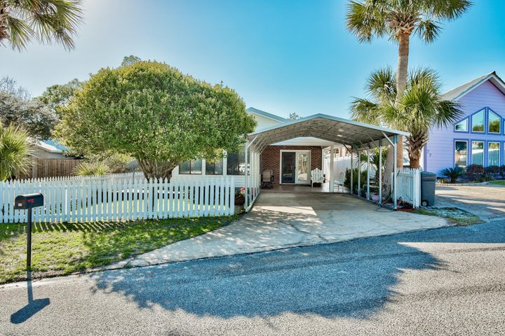 "This delightful home is located in the ""Brickyard"" neighborhood off Scenic Hwy 30-A in Blue Mountain Beach."