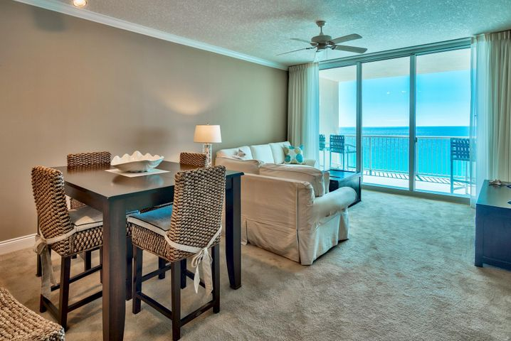 Immaculate, well maintained & appointed 2-bedroom, 2-bath Gulf front condominium with a bonus room at Palazzo, a premier luxury resort on the west end of Panama City Beach. This is the BEST PRICED 2 bedroom unit at Palazzo and is a fantastic investment - it also includes a private storage cage P2-06 for all your beach gear! The bonus room can easily be converted into a custom bunk room for additional sleeping capacity. Capture stunning views of the Gulf of Mexico from the kitchen, living & dining area and Gulf front master bedroom. Floor to ceiling windows  & doors truly maximize the views and bring the outside in. The open floor plan & raised ceilings allow the unit to feel very spacious and great for entertaining. Crown molding extends throughout the main living areas and master bedroom. This unit is being sold fully furnished and decorated along with flat screen TV's and great patio furniture. The teal matches perfectly with the emerald green waters. Access a spacious 253 sq. ft. balcony from the living area and master bedroom, which is the perfect place to relax, dine or entertain. Feel the cool breeze, hear the waves and unwind. The 8th floor is an ideal location in the building - not too high, not too low. With 4 levels of underground parking this is 12th floor elevation. The interior is welcoming and well kept. There is an open living & dining area and a breakfast bar for casual dining. The kitchen offers granite countertops, ample cabinets and storage along with a pantry, recessed lighting and Gulf views.   The Gulf front master bedroom has direct access to the balcony, beautiful views of the Gulf of Mexico and crown molding. It offers a king bed, flat screen TV, walk-in closet and en-suite master bathroom. The bathroom is quite large with a double vanity, granite countertops, Whirlpool tub and separate walk-in shower. The guest bedroom is separated from the master in the front for privacy and has a queen bed. There is an additional bonus area (currently bei