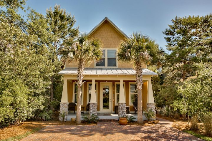 This beach cottage is a dream! Located just a .25 miles from Ed Walline beach access and Gulf Place, you'll have shops, dining and summer concerts all a short walk away. This beach cottage is as charming as they come. Tile floors flow throughout the main floor, granite counter tops in the kitchen and bathrooms, and stainless steel appliances are just a few of the features. The main floor master and large bedrooms with 2nd master and loft space upstairs make it ideal for a primary, second or vacation rental home. This home has it all, including the furnishings, making it turn key whether you're thinking of an investment home or will be lucky enough to move in yourself. This picture perfect beach home in a small, low maintenance community is the gem you've been waiting for!