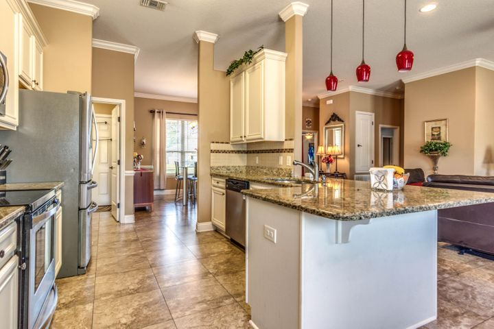 Breakfast bar at kitchen counter, open to living room and breakfast nook