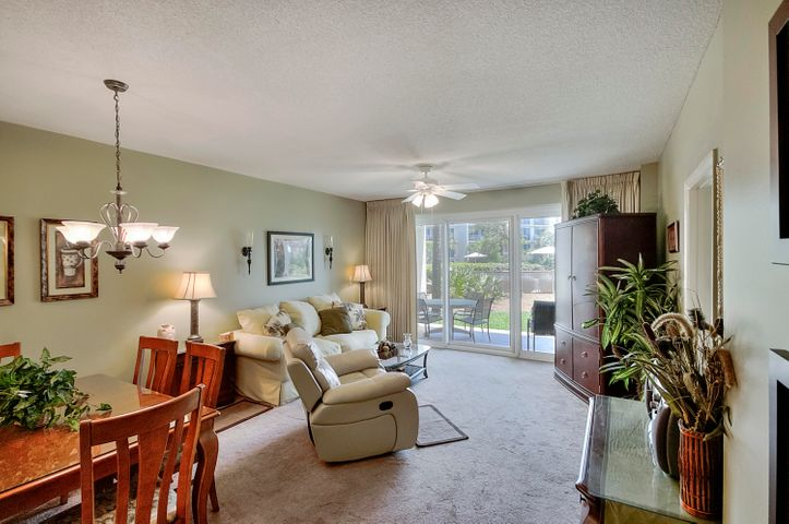 Spacious living room with direct access to the covered patio, community pool and Gulf access.