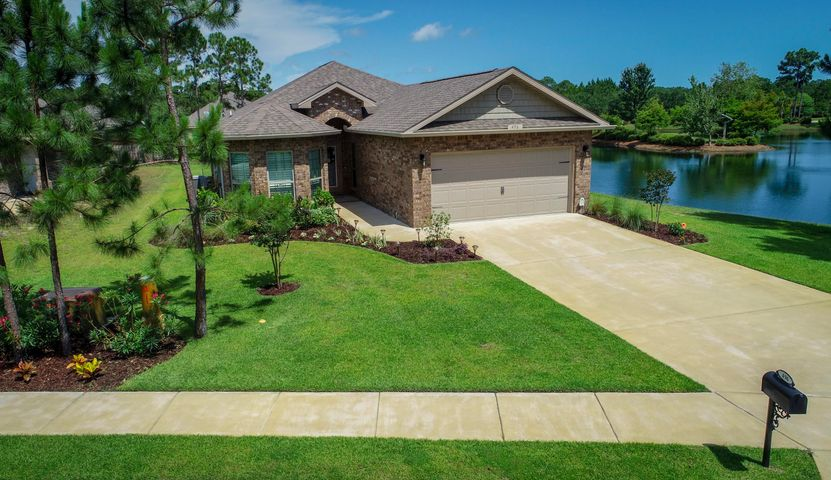 Welcome to 496 Pin Oak Loop strategically positioned on its premium lakeside lot.