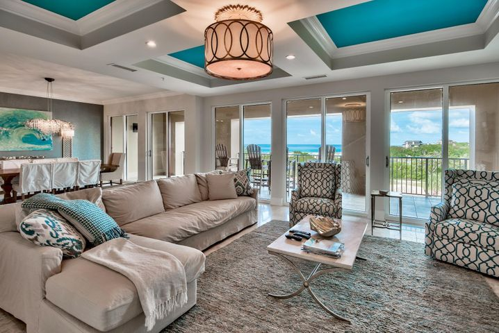 Living Area with coffered ceiling, recess and custom lighting and views of the Gulf.