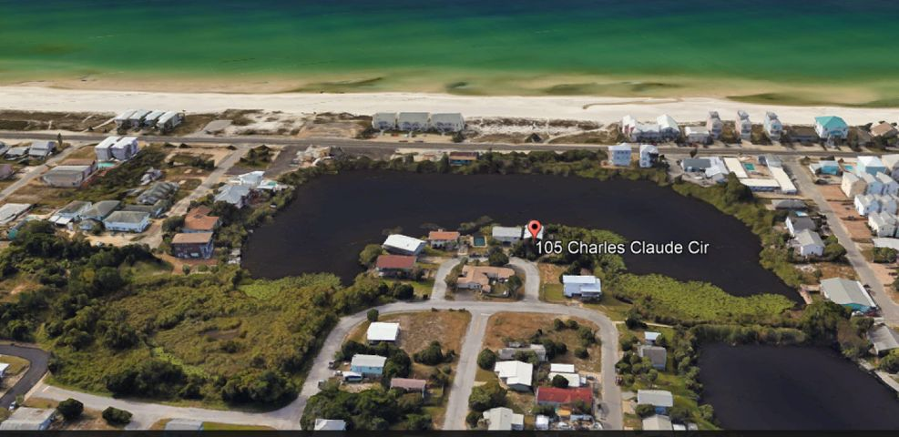Hurry grab this Lakefront property with Gulf View! This property is located on Lake Charles-Claude(a natural Dune Lake). Your just two blocks from the Gulf of Mexico and less than 5 minutes from Pier Park and Frank Brown Park. This is a quiet neighborhood that's very secluded. Value in land only. Lot can also be subdivided into 2 lots. House is unsafe and needs to be torn down. Do not walk on decks or try and go in house without appointment.