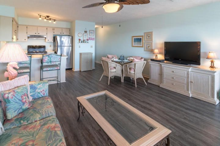 Move into a completely renovated building in one of the most desirable locations in PCB!  Over the past year, building H has been transformed - the renovation of the entire complex is scheduled to be complete at the end of summer.  Just 10 miles south of the airport, 2 miles west of Pier Park, 1/2 mile east of Thomas's world-famous Donuts, and feet away from the world's best beach - the crystal clear waters of the Gulf of Mexico are less than 2 minutes from your door.  The back balcony provides a Gulf view and overlooks a tranquil protected marsh where the frogs provide a serenade after each day's beautiful sunset. Recent updates to the interior include new waterproof flooring, light fixtures, outdoor furniture and fresh paint. Sleeps six and ispresented turn-key-all furnishings down to the dishes, silverware and linens are included. Has been a second home -- never been rented. Southwind has a great rental history in the country's Number 1 rental destination, with amenities such as clubhouse, pool, shuffleboard, and tennis. If measurements are important it is the responsibility of the buyer to verify.