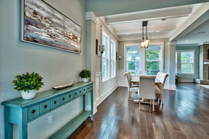 As you enter the foyer 12' ceilings invite you into the open floor plan