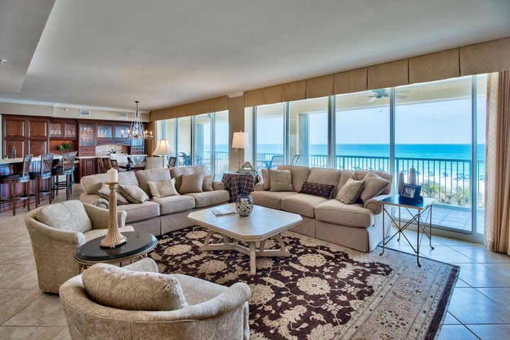 Phenomenal fully renovated custom unit at Oceania with a 60 foot wide balcony that looks right out onto the pristine beaches and emerald green waters of the Gulf of Mexico. This unit it just under 2,000 square feet and has floor to ceiling glass windows & doors that span across the entire front of the unit bringing the outside in. The views are truly breathtaking, not to mention the sophisticated and elegant interior. This unit has never been a rental unit and is impeccably maintained. Interior has been fully updated (~$260k) with beautiful custom wood cabinets, marble countertops, new kitchen appliances, updated fixtures, sinks/tubs, lighting & flooring. All bedrooms offer en-suite bathrooms and are generous in size. The unit is being sold fully furnished & decorated and is sure impress! The floor plan is incredible with an open living & dining area capturing beautiful views of the Gulf, crown molding and raised ceilings. There are remote controlled blinds along with plantation shutters in some of the bedrooms. Porcelain floors extend throughout the main living & dining areas and master bedroom - great for beach living! The guest bedrooms has new upscale carpet. The kitchen has also been fully renovated and is exquisite. The rich hardwood cabinets have a delicate trim and set the tone for the kitchen. The custom cabinets and glass extend to the wet bar area along with stunning marble countertops and a beautiful tiled backsplash. There is a formal dining area with Gulf views and a breakfast bar for more casual dining. The dining and living area opens up to the massive 60 foot balcony, which is the perfect place to unwind, enjoy the sunset or entertain.   The master suite is on the west wing of the unit and is a great sized room with a seating area, direct balcony access, walk-in closet and impressive en-suite master bathroom. The bathroom has marble countertops, double vanity, custom cabinets, Jacuzzi tub and separate walk-in shower. A wall was opened up to create a