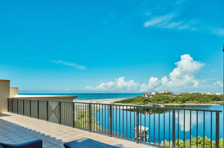 Amazing opportunity to own this top floor two level luxury condominium residence in Sanctuary by the Sea with Gulf & Lake views! This home is priced to sell and is offered fully furnished.  This third floor unit offers remarkable westerly views of Big Red Fish Lake and the Gulf of Mexico.  This 4 bedroom 4.5 bath two story home has two master bedrooms.  The first floor offers one master off of the waterfront balcony and two additional bedrooms with private baths, laundry room, hall bath, open living and dining area with a gourmet kitchen, granite counter tops, custom cabinetry, and a 10' x 38' covered balcony.  The second large master bedroom (800 sq ft)is located on the second level with a massive 22' x 38' balcony boasting a forever western view of Big Red Fish Lake & the Gulf of Mexico. Sanctuary by the Sea offers an unmatched coastal lifestyle with Beach and Coastal Dune Lake frontage, three  community pools, covered parking, fitness center and gated entry all located on the South side of Highway 30A between Blue Mountain Beach and Grayton Beach and walking distance to local shops and restaurant.  SBTS offers a haven of serenity and privacy unequaled with only 82 condominium residences on 23 secluded acres nestled by over 1,500 ft of frontage on Big Red Fish Lake and fronting 650 feet on the Gulf of Mexico.  Within  the Mediterranean style stucco exterior, luxury is a standard; every residential unit offers 10' ceilings, wide crown molding & 7'' baseboards, 8' doors, gas fireplace, wet bar, tiled balconies, travertine tile in dining, living, baths & laundry. This lush private setting with a poolside waterfall is complemented by diverse amenities including underground parking, 4X10 storage cages, three sparkling pools, gas fire pits, poolside grills, fitness center, lakeside canoeing, movie theater, video game area, owners lounge and virtual golf.