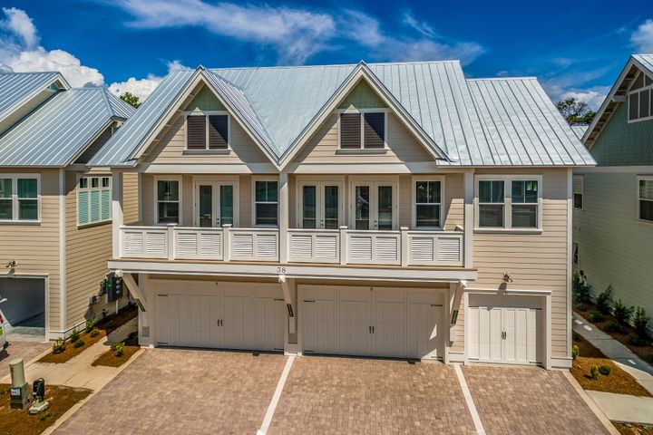 Gorgeous exterior includes pavers for driveway. Two car garage with this unit.