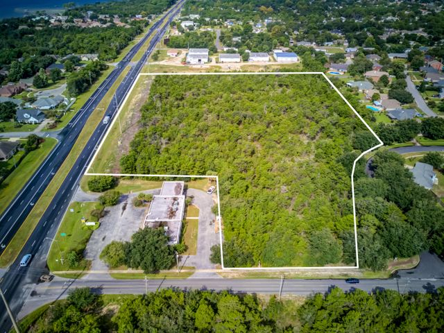 Prime development acreage yielding+/-9.5 acres and over 650' along Highway 98 in Santa Rosa County, Florida! The adjacent corner parcel, which contains a vacant bank building measuring approximately 4,438 SF, is available as well, listed separately under MLS 805027. Zoning is as follows: (HCD) Highway Commercial Development District.Buyer must very all information and specifications.