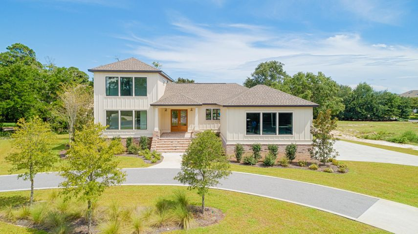 BRAND NEW CONSTRUCTION!! Incredible 2-story home offering 43 feet of frontage on the canal in Soundside East in Gulf Breeze. This home is built on nearly a 1/4 acre corner lot along with a dock & boat lift (additional fee). This new construction home features a wide open floor plan great for entertaining. The back opens up to a fully covered lanai. You will be impressed immediately upon entry with the welcoming great room including a fireplace and large kitchen with beautiful Quartz counter tops & over sized island overlooking the dining area & dry bar. There are 2 bedrooms conveniently located downstairs including the spacious master suite complete with a walk-in closet & stunning en-suite bathroom. The en-suite master bathroom with double vanity, large soaking tub & separate walk-in shower. The second level features two additional guest bedrooms each with en-suite bathrooms. There is a bonus room that is perfect for an additional living area to relax in or playroom for the kids! This custom home is well thought out with prime attention to details. There is a 2-car garage and covered porch at the entry for great curb appeal. Start enjoying the coastal lifestyle from your own private dock with a boat lift (for an additional cost). Take in the serene environment or even kayak or paddle board the canal. This property and craftsmanship is sure to impress!