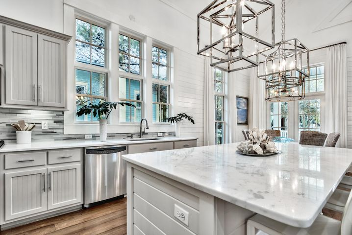 Gourmet kitchen with marble counter tops and new designer light fixtures