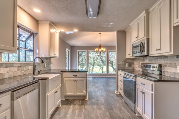 Kitchen has Granite Counters and Stainless Appliances