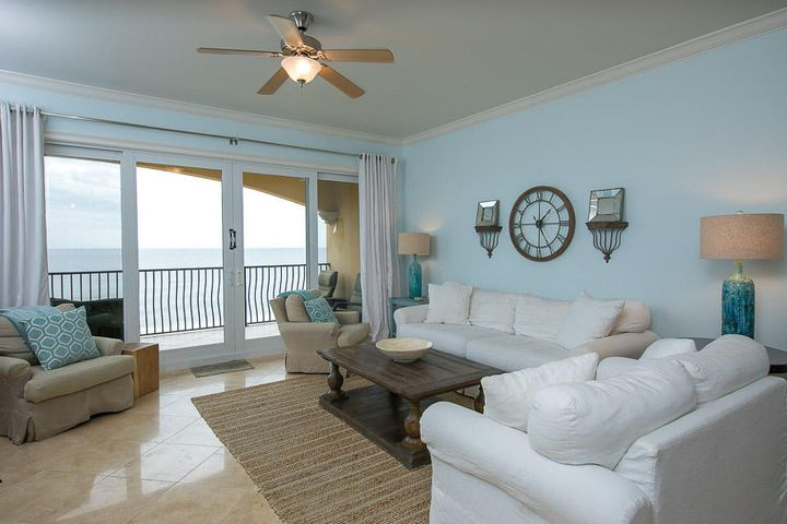 Large Gulf front living area opening to a big balcony.