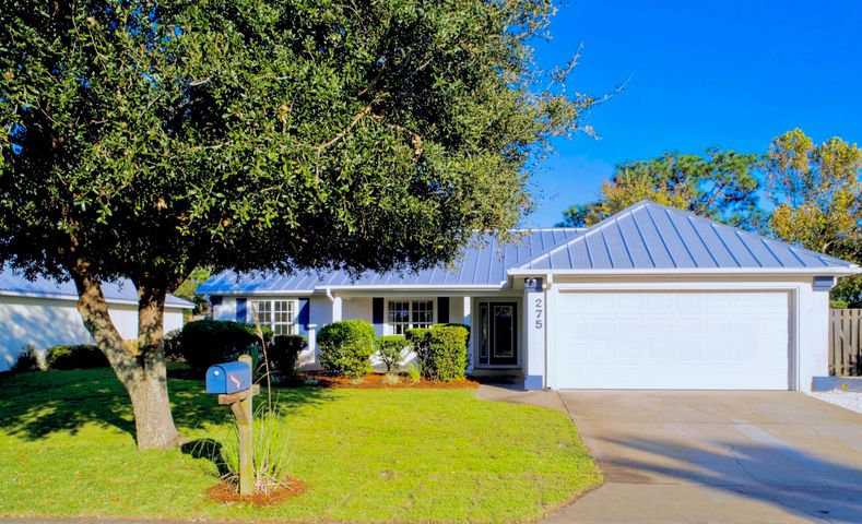 Home sweet home! This perfect 3 bedroom, 2 bath home is located on the west end of Scenic Hwy 30A, within walking distance of two public beach access points, Van R. Butler Elementary and Topsail State Park. Emerald Walk is a quiet, charming community with no through traffic and incredibly low HOA dues! This immaculate home has been recently updated with brand new flooring throughout, fresh paint, granite, a new hot water heater & Whirlpool stainless steel appliances. Exterior updates include new landscaping, irrigation, an extended driveway and the metal roof is only 1.5 years old! The .25 lot backs up to undeveloped state forest with private access to nature trails! The fenced in back yard offers plenty of room to add a pool.