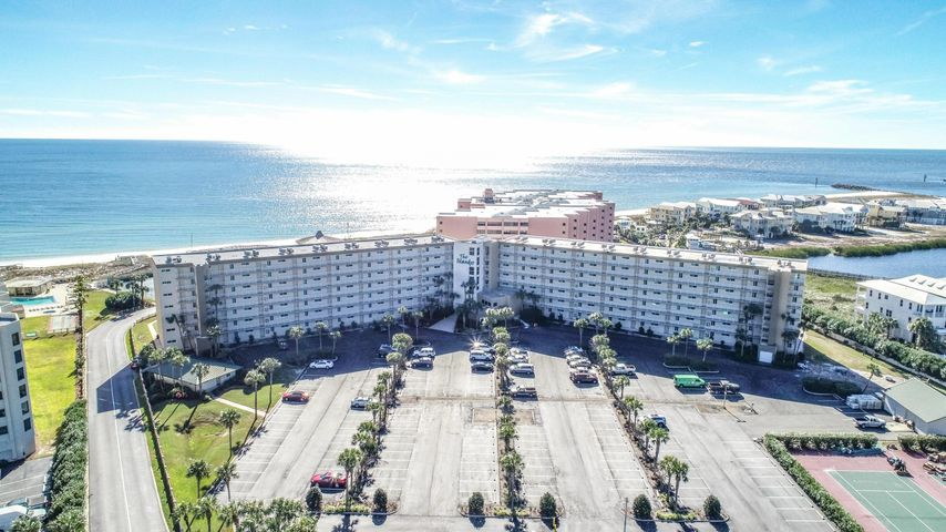 This superb condo is located in the heart of Destin, FL - a #1 ranked beach and vacation spot in the United States!  This first floor unit allows for ease of use with no elevator needed and easy access to the beach and pools! First floor units tend to rent more - 2018 - Gross rents  $32,430 and 2019 over $30,000 already on the books! The Islander complex has a gated entry, 2 pools, a hot tub, workout room and BBQ area. This is a pet free community with its own private beach access. The condo has easy access to the parking area making unloading the car a breeze and seller will provide $1500 credit for installation of washer & dryer hookup.  The kitchen is upgraded with granite counters, a huge breakfast area with ample counter space, stainless steel appliances and tile flooring. **No Pets** The kitchen overlooks the living room and dining area and has a view of the back patio - a fantastic space for entertaining! Out the back patio is the path to both pools, beach access and BBQ area.  There are 2 large bedrooms both with their own full bathroom and good sized closets. This condo comes furnished.  2019 - Monthly HOA Dues are $617 HOA covers: Building and ground maintenance, landscaping, pest services, insurance for the building, management costs, and funding the reserves 100%