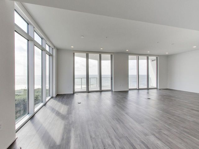 Great Room With A Pair Of Sliding Glass Doors To The Gulf Front Balcony