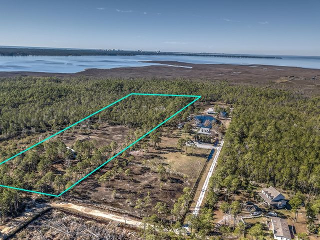 Just a few short miles from the Emerald Coast beaches and near the Choctawhatchee Bay sits this beautiful 10 acre property ready for its new owner. Canal leading to Bayou/Bay on rear of property. There's plenty of room for horses to roam and dogs to play without running into the neighbors. Garden-lovers have plenty of room for flowers, vegetables, herbs or all of the above. Whatever you can envision, can come to fruition. The mobile home sitting on property is in good condition.  Adjacent 10 acres with 5 bedroom home available to purchase.