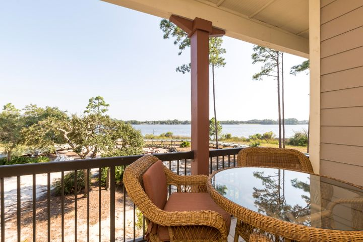 Step into one of the most sought after locations in Wild Heron. Walk through an arched column entrance living area and experience water-view at its best.. Unit is 2/ bd/rms and 2/baths.Travertine floors throughout, granite countertops, Wild Heron is nestled in a 750 acre coastal sanctuary with Lake Powell, rare coastal dune lake. Outside your door is a State of the Art fitness center, pool, community park, and playground. Other amenities include library/owner's lounge and boathouse including access to free kayaks to explore Lake Powell., golf, tennis center, covered gazebo with fireplace, and a lakeside fire pit. Very convenient location, Located 5 minutes from Pier Park and 5 minutes from 30A and Rosemary Beach. It's time to make Wild Heron your home. Every day is an adventure.