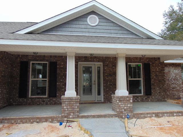 Parrot Bay IV covered Front Porch. Craftsman style Columns and shakes. Colors and Options may vary