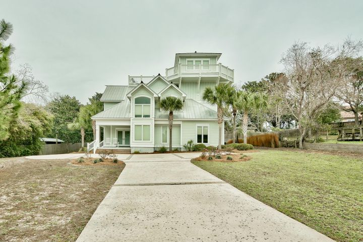 "Amazing 4-bedroom home with an impressive ship's watch with Gulf views on a half acre lot, just blocks from the beach! There is also a bonus room, mud room, fantastic covered porch leading to the backyard, upper balcony for two suites and the open top floor deck. This stunning home is being sold fully furnished and decorated making this move-in or rental ready. Luxury features and fine details can be found throughout, including stunning marble counters. Recessed lighting accents nearly every room, and a built-in sound system ensures entertainment wherever you go. 20'' tile flooring extends through the living, dining, kitchen & hallways. The open & spacious layout is designed for entertaining large groups and the abundant large windows bring in lots of natural light adding to the open feel. From the living room and dining room, double doors lead to the large patio outside that is perfect for grilling or just relaxing in the fresh air. The kitchen is impressive featuring stainless steel appliances, crown molding, recessed and pendant lights, marble countertops, craftsman cabinets, and a large marble breakfast bar for additional seating. There is dining area for 8 for a more formal setting. A walk-in pantry offers additional storage, and a mud room makes it easy to dust off from a day at the nearby beach. Wainscoting, recessed lights, and craftsmen quality window and door frames add an elegant style to the home.  There are conveniently two bedrooms on the first floor. One bedroom features 20"" tile floor and a wide closet, while the other bedroom offers tile floor and two sets of bunk beds that will sleep 4. A full bath with a large granite vanity, wainscot walls and tile shower is located conveniently between these two rooms. A first floor laundry room comes complete with a granite counter, utility sink, additional storage space and full size washer and dryer that convey with the sale. A hardwood staircase leads upstairs past immense windows that brighten the house even more.  The master bedroom features wainscot walls, recessed lighting, and doors leading out to the balcony, which is an ideal spot for relaxing and enjoying the fresh sea breeze. The en-suite master bath is simply breathtaking! This bathroom features a giant walk-in tile shower with 3 shower heads and glass block accents, a separate tile whirlpool garden tub, dressing area, 2 granite vanities, and a walk-in closet. Also on this level is an enormous ""second master"" bedroom  furnished with a king bed and doors leading onto the 2nd floor balcony deck, which is shared by both bedrooms. Just outside the room you will find a very large full bath, with a beautiful arched window, sitting area, a granite double vanity, linen closet and tile shower tub. Further upstairs is a great bonus room that would make an excellent media room, studio, or office.  The centerpiece of the home is a top floor ship's watch with sun deck and wrap-around balcony. This large room is perfect for entertaining guests! Hardwood floors, a granite wet bar with mini fridge, ceiling fans and a built-in sound system surrounded by large windows with picturesque Gulf views will make this the most popular room in the home. The big sundeck is large enough for even the biggest group to gather and enjoy. The wrap-around balcony offers exceptional views in all directions, with the Gulf visible just a few blocks away.   This home is located in the quaint Gulf Pines community, which offers deeded access to the beach via a boardwalk, pavilion and gazebo. Deeded beach access to one of the most pristine and uncrowded beaches in Miramar Beach! This quiet community is nestled within gorgeous native Florida coastal woodlands and offers a beautiful sense of serenity and privacy, while being just a short walk off the beach. The neighborhood is a mixture of vacation rentals and full-time residents, so if you are looking for a quiet spot away from the hustle and bustle of the peak season, then look no further! There is also a great lake within the community with a park.   You won't have to travel far to enjoy all the wonders this area has to offer. You will be just minutes away from fine dining, upscale shopping and nightlife! The central location is just minutes away from the dining, shopping, and nightlife of the The Village of Baytowne Wharf, Grand Boulevard, Silver Sands Outlets and the legendary charm of the 30-A area. Gulf Pines is one of Miramar Beach's hidden gems with a laid back ""Old Florida"" feel locals desire, yet still high luxury. Don't miss this opportunity to own this amazing home right in the heart of the Emerald Coast!"