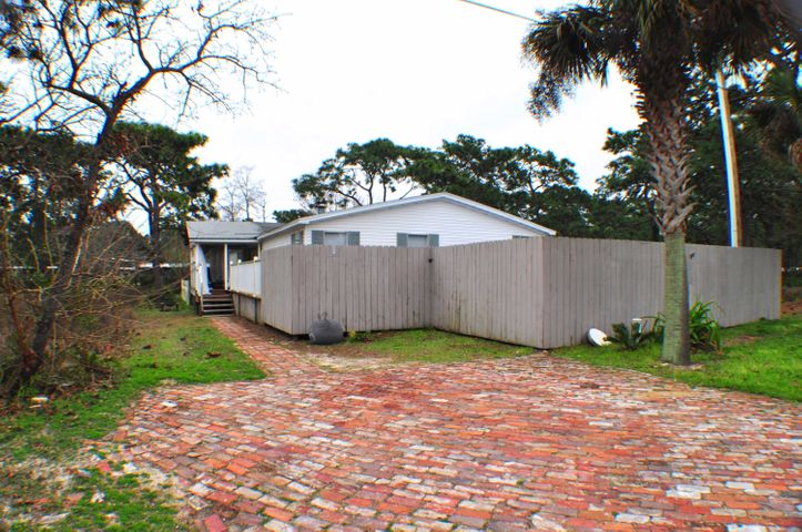 Fantastic investment property in Seagrove just a few blocks from a dedicated beach access! This is a 4BR/3BA manufactured home with two bonus rooms and a pool. There is approx. 2,280 sqft of living space inside, two covered porches front and back, a large open deck surrounding the pool, two storage sheds and even a dog run. The sellers recently upgraded the flooring, there's a fireplace, and all kitchen appliances convey. If you've been looking for a vacation home in a quiet spot but close enough to the beach, shopping, dining and more, you couldn't ask for a more perfect place! All info is approx. and must be verified by Buyers if important.