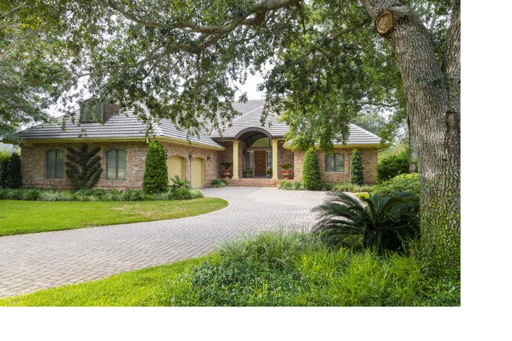 #152's curb appeal from Indian Bayou Drive. 4,281 SF - 3 bedrooms plus a bonus room plus an office plus, plus, plus...