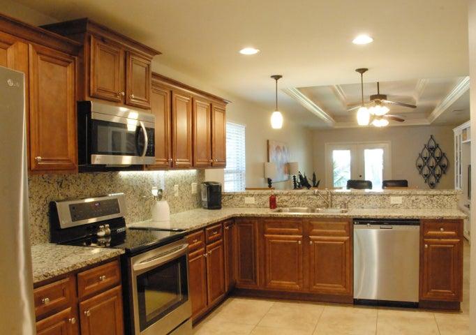 Kitchen w/ Granite, SS Appliances & Wood Cabinets