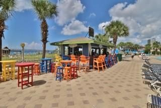 Just steps away from the beautiful sands of PCB from this great location on the ground floor of the Summit! MUST SEE This condominium is located on the beautiful beaches of the Gulf of Mexico in Panama City Beach, Florida. It is at The Summit on Thomas Drive. You will find yourself within walking distance of restaurants, amusement parks, golf courses, and more. Grills are provided on site if you enjoy cooking out. There is also a TIKI bar in the pool area which is close to the beach so you can get a cool drink any time without leaving the property. A bar and grill called Bikini Bobs is onsite for food. The Summit has two large pools for guests as well as both indoor and outdoor hot tubs! An exercise room is located on the ground floor near the lobby for guests as well The master bedroom in this beautiful unit has a king size bed, twin size day bed and a large flat screen tv. It has private access to the bathroom. The bathroom has a shower/tub combo and a connecting half bath with access from the hallway.   The hallway has 2 twin size bunk beds.  The oceanfront living room has a QUEEN size sleeper sofa, a large flat screen tv and access to the oceanfront balcony.  The kitchen comes fully stocked with everything needed to cook a great meal!   This unit and the unit next door are some of the best at The Summit! Being able to rent both together makes it even better