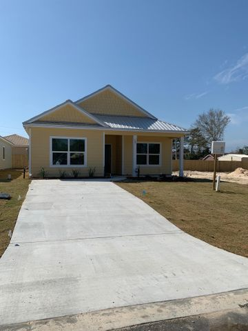 Today is the day that you can realize your dream of owning your own BRAND NEW Beach Home, just steps away from Lake Powell and a short walk to the Worlds Most Beautiful Beaches of Panama City Beach and the Beaches of 30A.  Osprey Pointe at Powell is a new 17 home subdivision on Lakeview Drive at the west end of Panama City Beach.  These homes are ''Coastal Cottage Cuties'' in a golf cart friendly community with Hardy-Board siding, metal roofs and quality construction.  Home has beautiful granite countertops in kitchen, Stainless appliances and ''above builder grade'' fixtures and flooring choices .   See Additional pics for floor plan information and videos of model home and drone footage of neighborhood and site.  Storage options available.
