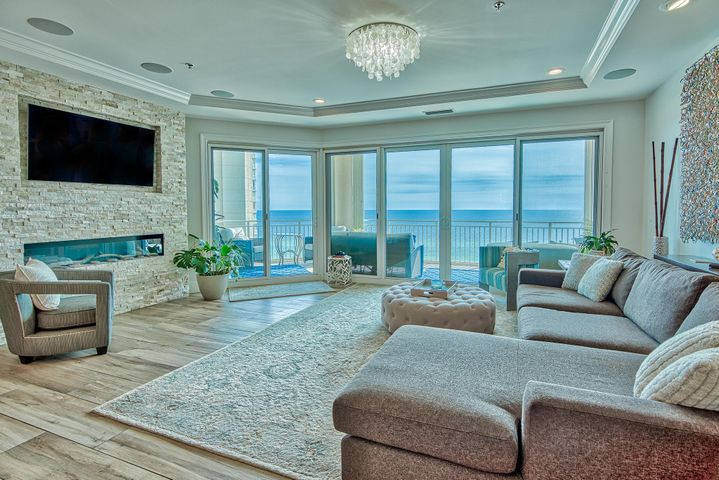 "Phenomenal platinum level condo with panoramic views of the Gulf and Bay and exceptional one-of-a-kind custom updates throughout. This is the only 4-bedroom unit available for sale in the North Tower and has been completely updated with countless luxury features totaling over $350,000! Elegant features include oversized 12'' x 48'' wood plank tile floors throughout, Quartz & Vetrazzo countertops, tray ceiling & crown molding, recessed lighting in addition to stunning custom light fixtures, enhanced built-in sound system, dream kitchen with high end Wolf & Sub Zero appliances, custom backsplashes and unique decorative details, Marquis soft close custom cabinets, added custom bar for entertainment and the list goes on! Stunning Gulf views surround you with easy access to an expansive balcony This incredible unit overlooks 70+ miles of our beautiful coastline and white sand beaches. The private balcony is tiled and includes a deluxe Lynx gas grill with sear feature and built-in lights. Gorgeous views of the Gulf will take your breath away plus you can even hear the surf. This is the perfect place to relax, unwind or entertain and enjoy outdoor dining. Full coverage hurricane shutters have been installed for storm security. This incredible unit overlooks 70+ miles of our beautiful coastline and white sand beaches. Access the balcony from the living area or master bedroom. This is an amazing floor plan as you have two gulf front bedrooms with en-suite baths and the additional two bedrooms offer views of the Bay. The living area defines luxury living with unsurpassed views, a linear 5' gas fireplace with LED lighting and beautiful beach accents including driftwood & stone that highlight the room along with a 65"" TV nook above. This is definitely a statement piece. The spacious living area opens up beautifully to the dining area accented with a custom bar that you won't find in other units. The bar is conveniently located and features a stunning unique shell back splash, under cabinet lighting, and the Vetrazzo countertop and Sub Zero beverage fridge makes this area exceptional. Dine to Gulf views and have additional guests relax at the oversized breakfast bar & island with gorgeous crisp Quartz countertop, custom soft close cabinets complete with hidden cabinet front Asko dishwasher and double trash area, and even multiple USB & power outlets - not a detail was missed with the unit! Above the island are custom glass pendant lighting. The kitchen is a chef's delight with top of the line appliances including Wolf 36"" professional range top with griddle, range hood, 2 Wolf ovens - a steam/convection and a regular/convection oven, and a 48"" Sub Zero refrigerator. Vettrazo countertops extend throughout the rest of the kitchen (to match the bar by dining area) and there is plenty of storage with ample cabinets and upscale walk-in pantry including a dual zone SubZero wine refrigerator, Vetrazzo counters and additional storage space.  The Gulf front master suite is pure elegance! As you enter the space there is a grand entrance with a three dimensional tiled accent wall  and the master bedroom is just to the left along with an additional bedroom to the right that could be a fantastic office for the master quarters. This space is complete with a large walk-in closet with shelving and phenomenal en-suite bathroom. The bedroom is generously sized and Gulf front with breathtaking views that illuminate the fine crown molding, tray ceiling and wood plank tile floor. Step out onto the balcony to enjoy the fresh sea air and enjoy your morning coffee! The en-suite master bath is remarkable with incredible custom tile work in the shower that wraps around above the soaking tub. The master shower has been reconfigured to eliminate the need for glass and lends to views of the Gulf. There is a dual shower heads, hand shower and rain head. Pamper yourself in the deep, heated soaking tub with beautiful surrounding Quartz and custom glass tile below. The same tile accents the dual vanities along with custom cabinets offering more storage than traditional units. Each vanity throughout the unit features a Quartz countertop, high end custom lighting, Kohler sinks and new plumbing fixtures (Hansgrohe). The powder room even features a unique glass sink that is sure to impress. The guest showers features seamless glass doors.   There is an additional Gulf front bedroom on the opposite side of the unit for added privacy. The oversized glass windows enhance the emerald green views of the Gulf and this room has a great en-suite bathroom with custom tile work in the shower. There is another guest bedroom towards the front of the unit that has fantastic views of the Bay complete with an en-suite bathroom. The laundry room is configured for a full size washer and dryer and offers Quartz countertops on both sides and cabinets for additional storage. There are even hidden under cabinet outlets for convenience. Additional details have been thought out during construction like added new & upgraded insulation, sound proofed sub-flooring, waterproofing to all showers and kitchen walls, tile laid under all cabinets (original units have bare concrete underneath), LED lights with dimmers, and Aquasauna water filtration & softening system. Carrier AC was installed January 2018 with a 10 year warranty and Cor smart thermostat. There is new Emtek hardware on the 8 foot doors with modern levers and matching hinges and door stops. The remodel was completed in 2017 and construction materials and labor are now up approximately 20%! This is an incredible opportunity to own one of the nicest units in the history of Grand Dunes.   Grand Dunes is a secured, Gulf front gated resort and upscale amenities include private high speed elevators that open directly into foyer of your unit, designated beach with seasonal beach service and private boardwalk (just redone) with wash stations, large Gulf front lagoon pool surrounded by Palm trees with a cascading waterfall & hot tub, a private second pool & hot tub for the North Tower, grand lobby, tennis, ample underground parking, Gulf front exercise room, private Owners' Lounge, conference room, billiard area, and 2 suites for overflow guests. This property does not allow short term rentals and is a perfect full time residence or true second home. Live at South Walton's finest high rise development and enjoy easy, low maintenance beachside living. This unit will not last long!"