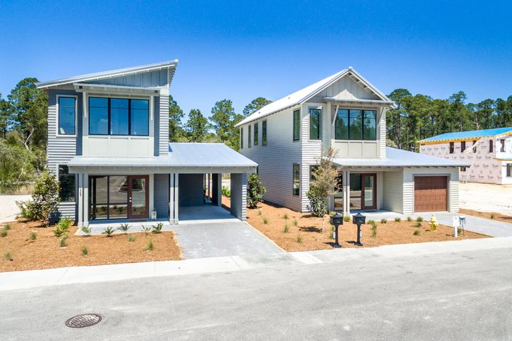 New floorpan with master on first level. You've discovered SOUTH WALTON'S NEXT GENERATION HOMES! Brand-new homes in on Historic Point Washington, thoughtfully designed for today's families. Enjoy the privileges of living the good life as a local. The State Park & school are steps away, and public boat launch just a few blocks. Open floor plan and outdoor ''rooms'' are part of the way you want to live NOW. Select your fixtures and colors, and enjoy a new home built your way. High quality construction with storm-rated windows. Ask about our Closing Cost assistance. Photos are of similar model. This home is to-be-built. This home can also be purchased with a carport for $374,900.