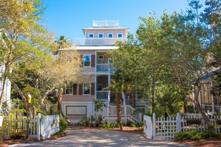 You can't get any closer to Seaside than this! This home has all of Seaside's charm without any HOA dues or restrictions, offering the best of both worlds. The shops, dining, and entertainment of Seaside are truly steps away to this Seagrove location. It boasts an overabundance of parking-a rarity in this area - and the lot is HUGE, with plenty of room for a large pool and even more outdoor living space. The main house is an ENTERTAINER'S DREAM with a large kitchen open to the living, dining, and family rooms on the main floor, along with a full bath and multiple porches, giving great space to enjoy the lushly landscaped setting. The 3rd floor has 3 bedrooms, 3 baths, and leads up to a 4th story loft with rooftop observation deck overlooking Seagrove, Seaside, and the Gulf of Mexico. The ground floor of the main house has a 2-car garage and also a one-bedroom mother-in-law suite, with living room and full kitchen, which can be accessed internally or externally to provide rental income (currently rented) or an extension your home's living space. Behind the main house is a detached 2-car garage with a 1-bedroom carriage house, with full kitchen and living room above, which is also currently used as a rental. This house has ENDLESS POSSIBILITIES and with multi-million dollar homes all around, too! Call today to see this gem!