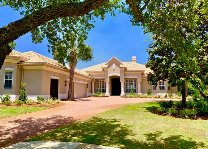 PRICE REDUCED! - Luxury, Privacy, and Fully Furnished! This perfect family estate is all one level, with almost 4300 square feet, on more than a half an acre. Located in the gated Burnt Pine neighborhood of Sandestin, on a large corner lot and cul-de-sac. This home has been recently renovated with a contemporary beach design featuring a bright white and grey color scheme, soaring 12' custom painted ceilings, intricate woodworking, solid walnut flooring, fantastic natural and interior light, and much more.At the center of the home is huge kitchen, dining room, and two living areas that all flow perfectly (through three walls of sliding doors) into the fully enclosed, screened-in outdoor space... complete with heated pool, spa, living and dining areas, fireplace, and outdoor kitchen.
