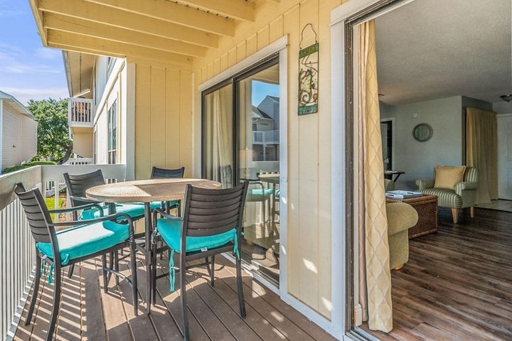 This beautifully decorated 2 bedroom/2 bath condo in Sanpiper Cove is located just inside the main gate and only steps away from the Emerald Green waters of the Gulf of Mexico.  It comes fully furnished.  The AC unit was replaced in 2018, new water heater as of 8/2019 and new TV's have been installed throughout.   You'll love spending your evenings on the back balcony.  Make your appointment to see this beauty before it's gone.