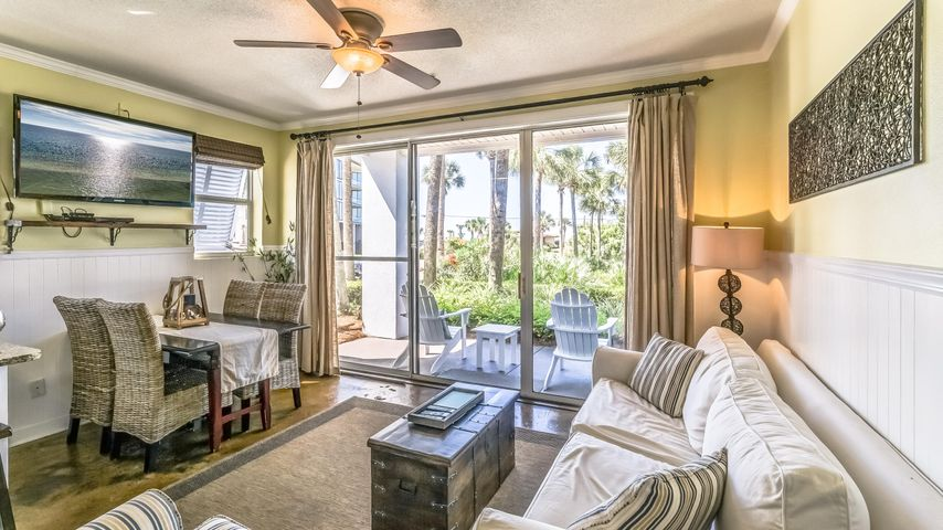 Welcome to Cabana Condo's at Gulfplace. This ground floor end unit is bright and open with modern updates. Along with being steps from the pool and a patio overlooking the pond, unit 101 has a gulf view and deeded beach access directly across 30A. The living area and kitchen feature stained concrete floors while the baths are tiled. Half wall bead board, granite counter top and appealing paint choices contribute to this tastefully decorated condo that is fully furnished. Added touches include barn doors, newly installed stainless steel appliances, a built in pantry and decorator grade window treatments. Another nice feature is the half bath located directly across from the double built in bunks. Unit 101 is an excellent choice for an investment property, second home or full time resident. Take this opportunity to enjoy all that Gulfplace and Dune Allen Beach along 30A has to offer. With excellent shopping and famous dining options close by you will love life along the Emerald Coast.