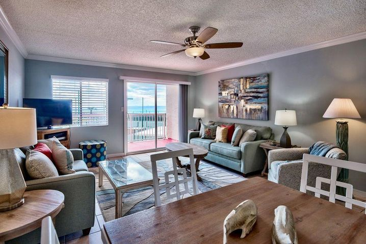 This freshly updated 1 bedroom unit at the popular Holiday Surf and Racquet Club has a beachy vibe with coastal colors and decor! Enjoy beautiful gulf views from this gorgeous condo's private balcony. This unit has a seasoned rental history and is turn-key! Holiday Surf & Racquet Club has tennis courts, shuffle board, boardwalk, his and hers exercise rooms, beautiful lobby, landscaping throughout the complex and game room! Don't delay and capture your piece of paradise today.