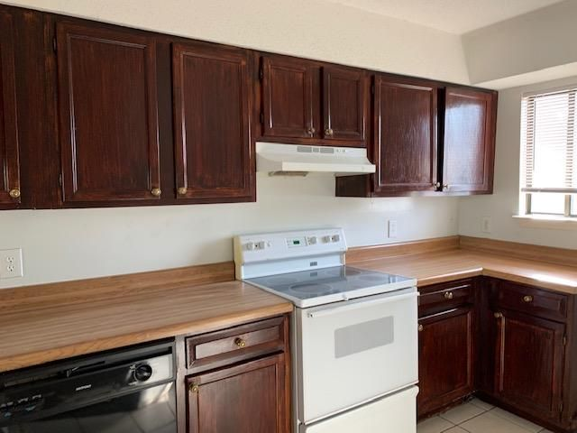 Spacious, Clean 2 Bedroom Town Home. Tile first level. Updated kitchen. ceramic top stove, Dinning, Living Combo. Pantry, lots of cabinets. Breakfast Bar, Slider out to covered porch with Fenced in backyard. All appliances convey,   Buyer to verify any & all dimensions.