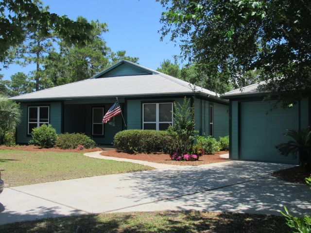 Price reduction!!! Are you looking for an affordable home close to the beach with all the wonderful amenities Santa Rosa Beach offers? End your home search today with this quality built custom home by Huff Builders. It has been well cared for and it shows like a new home without the big price tag. Open floor plan, tiled floors,  recessed lighting - all on a large lot on a quiet street. The master bedroom offers French doors that open onto the private screened in porch...a perfect place for your morning coffee and a good book. The kitchen features wonderful oak cabinets with all appliances conveying with home. This home checks all the boxes - all it needs is a new homeowner...YOU!
