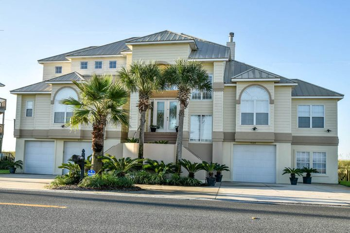 100' of Gulf Frontage in Navarre Beach. Located between Pensacola Beach & Destin on Florida's Beautiful Emerald Coast. This 4 BR/3.5 BA home is the ultimate beach house. Grand entry & living room w/20+ foot ceilings & views of the beach from the moment you walk through the front door. Open floor plan & lots of outdoor space make this home perfect for entertaining guests. The homes 3 levels are easily accessible via an elevator. The master suite encompasses the entire 3rd floor with a large master closet, private bath with whirlpool tub, large shower & fireplace. Other features include whole home audio system w/outdoor speakers, intercom system, custom fixtures, motorized and manual hurricane shutters, & landscape lighting. Escape the crowds and have lots of room to spread out on the beach.