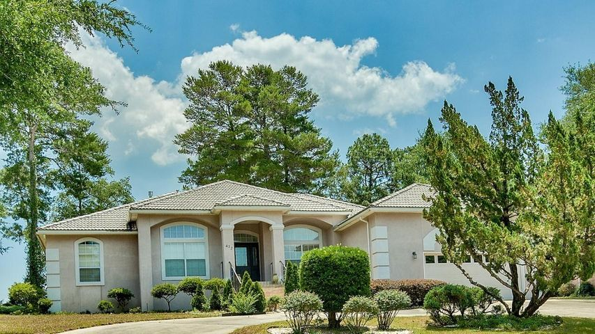 Large 3bdr/2bath stucco home in the heart of ROCKY BAYOU COUNTRY CLUB ESTATES
