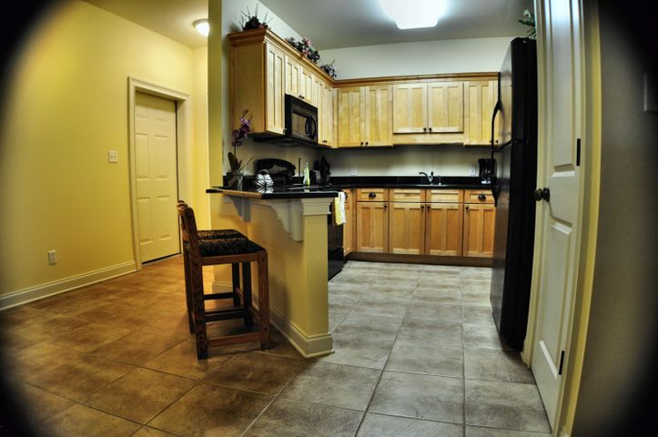 Fantastic 2 BR 2 BA Condo on 2nd Floor with Large Balcony over looking the pool. Open floor plan. All furniture displayed is included in price. No carpet. Tan tile in kitchen / living area and laminate floor in bedrooms. Topsail Village is less than a mile from public beach access. ** Motivated seller! **