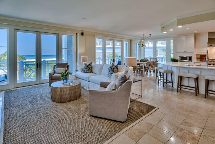 Move into this newly renovated three-bedroom condo in WaterSound Beach and enjoy all the benefits of this exclusive gated community. Accessed by elevator, this coveted corner end unit has a wraparound balcony delivering breathtaking gulf views with a choice of sunshine and shade at all times. Laura McKee of Dwell Interiors has weaved her magic with alluring new furnishings, handpicked artworks, rugs and home accents all included in the sale. Three bathrooms have also received an update to complement the soaking tub, beautiful tiles and modern vanities. The open plan living room is a spacious area for relaxing and entertaining. Throw open the double sets of French doors and enjoy the gentle sea breeze and glorious views across the dunes and Gulf of Mexico. Tile floors extend to the corner kitchen with its breakfast bar for casual dining. Newly upgraded, it is a well-planned space with new countertops, designer lighting, stainless appliances and fresh paint. Awaken each morning in the spacious master suite which has its own private balcony for peaceful morning views overlooking the sparkling emerald waters. The ensuite guest room and furnished bunk room for four make this an attractive condo for vacation rentals. Days will easily be filled with a visit to the WaterSound Beach fitness center or strolling the full mile of pristine white sandy beach. There's a dog park, puttering green and a children's playground, all connected by seven miles of meandering, traffic-free boardwalks and bicycle trails. Take a swim in the community pool nearby before heading for lunch at your favorite café on Scenic 30A. Deer Lake State Park has endless outdoor activities including kayaking and paddle boarding while nearby Alys and Rosemary Beach offer shopping, dining and entertainment.
